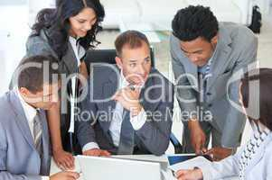 Multi-ethnic business people working together in a project