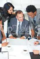 Manager and workers discussing in office a business plan