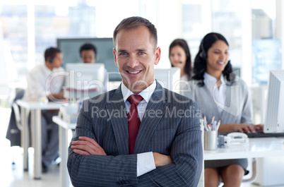 Smiling manager leading his team in a call center
