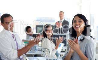 Businessteam applauding a colleague after a presentation