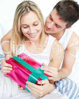 Boyfriend giving a gift to her girlfriend