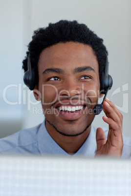 Afro-American businessman in a call center