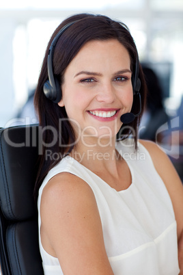 Portrait of attractive businesswoman in a call centre