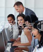 Businesswoman in a call center with her team and manager