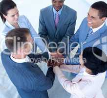 Smiling nternational business team with hands together