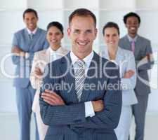 Business manager standing in office leading his team