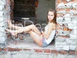 brown-haired woman has a rest on ruins