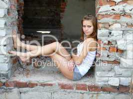 woman has sat down to have a rest on city ruins