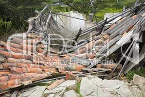 Collapsed house with terra cotta tile roof