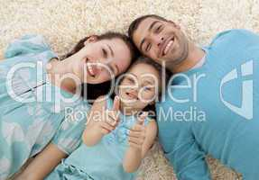 Parents and little girl on floor with thumbs up