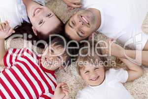 High angle of family on floor with heads together