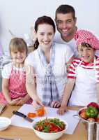 Family cutting colourful peppers in kitchen