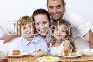 Children having breakfast with their parents