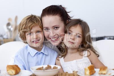 Children and mother having breakfast