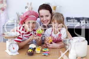 Mother baking with children in the kitchen