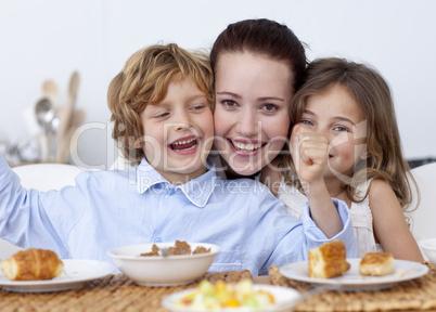 Children and mother having fun in breakfast