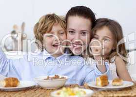 Children and mother having fun in breakfast