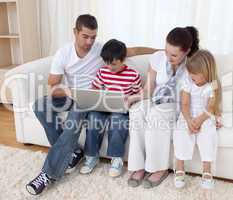 Family at home using a laptop