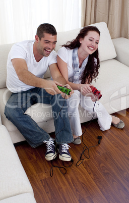 Couple playing video games in living-room