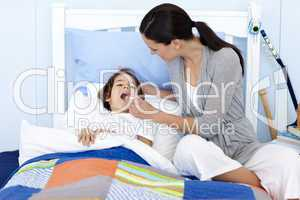 Mother taking her son's temperature with a thermometer