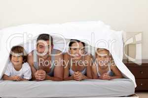 Happy family under the sheets