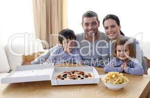 Family eating pizza and fries at home