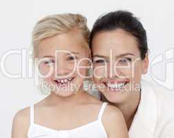 Portrait of mother and daughter in bathroom