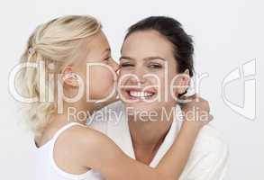 Daughter kissing her mother in bathroom