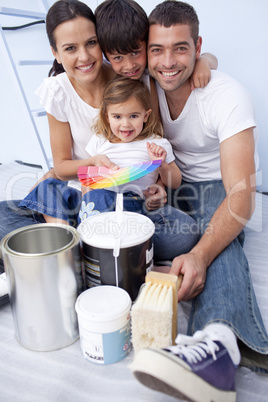 Family with colour samples to paint new house