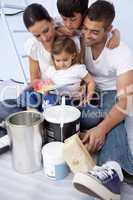 Family chosing colours to paint a bedroom