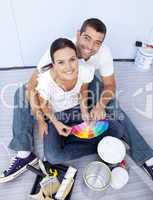 High angle of couple chosing colours to paint new house