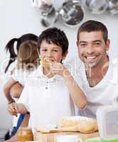 Father and son eating a toast in breakfast time