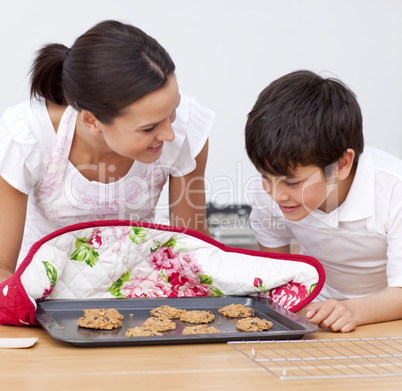 Mother and son looking at home-made biscuits