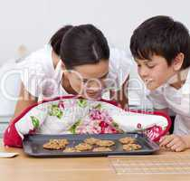 Mother and son smelling home-made biscuits