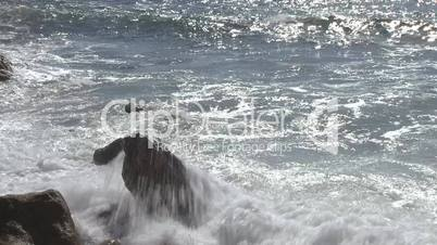Waves against rock in the beach