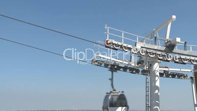 Cable car working against blue sky