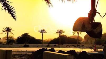 Bagger  bei Sonnenuntergang