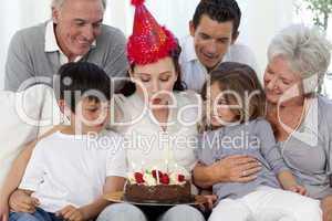 Happy family celebrating mother's birthday
