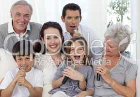 Family singing karaoke in living-room