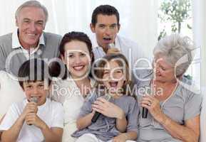 Family singing karaoke in living-room