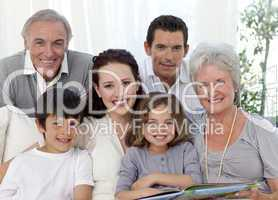 Portrait of family looking at a photograph album