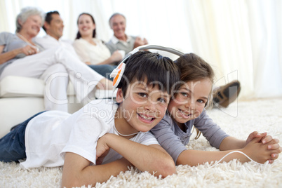 Children on floor listening to the music in living-room