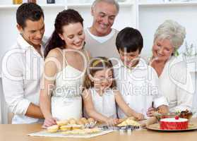 Parents and granparents looking at children baking