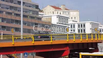 Metallic viaduct in the city cars