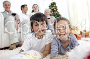 Smiling children looking for presents in Christmas boots