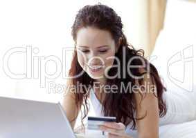 Smiling beautiful woman shopping online