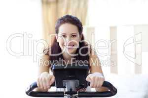 Smiling woman doing spinning at home