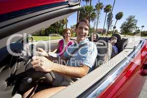Family Driving In Convertible Car