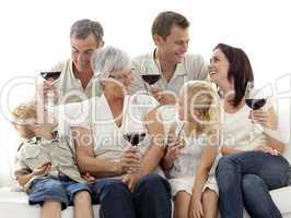 Family having a celebration with wine and eating biscuits