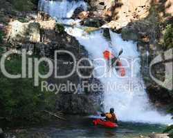 Kayaking On A Mountain Waterfall